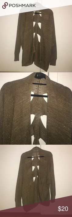 LF cardigan with open back Sparkly gold LF cardigan with 6 slits in the back. In decent condition. Great to wear with a black or white tank under! A little oversized LF Sweaters Cardigans
