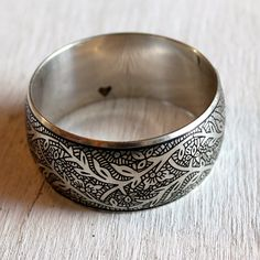 Purchasing this gorgeous silver-plated bangle from Rethreaded helps women escape the sex trade. <3