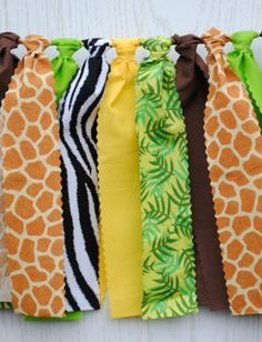 This jungle safari bunting brings the colors and prints of the jungle to your next party. The bunting coordinates with any jungle or safari party printables or other decorations. Giraffe Birthday Parties, Jungle Theme Birthday, Jungle Theme Parties, Wild One Birthday Party, Safari Birthday Party, Jungle Theme Baby Shower, Jungle Theme Classroom, Birthday Ideas, Luau Party