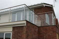 Glass Balcony Example by Craftsman Cladding for further information Call NOW on 0800 783 6211 or visit our website www.craftsmancladding.co.uk