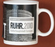 "Did you know this black & white mug IS part of the Starbucks city mug despite that it doesn't look like the others.  It represents the Ruhrgebiet region of Germany where the major city of ""Essen"" is located.  The region is also called ""Kohlenpott"" or just ""Pott"" as in a ""pot of coal.""  Starbucks produced very few of these mugs & it was sold in a few stores throughout these region.  The major historic industry was coal mining so this mug was produced in black & white to give a rugged dirty…"