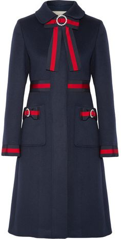 Gucci's equestrian-inspired stripes were first introduced in the '50s. Edged with signature blue and red webbing, this wool coat is detailed with neat bows and crystal-embellished brooches. It has a slightly loose fit and smooth crepe de chine lining that makes layering easy and comfortable.