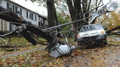 A lamppost was brought down with power lines Tuesday morning Oct. 30, 2012 on Uncas Street off Delaware Avenue in Bethlehem, Pa., following heavy winds and rain brought on by superstorm Sandy that caused widespread damage and power outages.