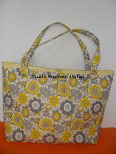 Bolsa amarela estampada