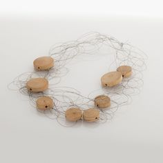"""""""Intreccio metallo e legno"""" is an handmade necklace, made of metal's wire and natural wood's elements. The particular production makes this optional soft and light. 100% made in Italy. Weight: 28 gr."""