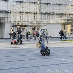 Tourists riding obn Segway transports in the summer in the Old city of Krakow, Poland. Europe.