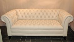 White tufted leather. I might have just found my future living room couch.