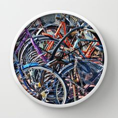 Lots+of+colorfull+bicycles+Wall+Clock+by+Claude+Gariepy+-+$30.00