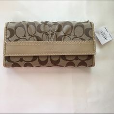 ⬇️Coach Soho Checkbook Wallet Patent Leather Trim ❤️Sale❤️ Great Gift Idea! Brand new Coach monogram fabric and patent leather trim checkbook wallet! The tag says Khaki/Putty for color. I believe the monogram fabric is Khaki and the leather color Putty. This is brand new with tags! Closed it measures approx 8x4.5x1. Open it measures approx 11x8. Coach Bags Wallets