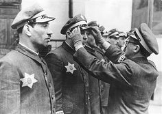 World War II, Warsaw Ghetto during the German occupation: members of the Jewish security service with the Yellow Star on their coats - pin by Paolo Marzioli
