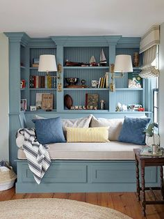 The owners of this Massachusetts house outfitted their son's room with a built-in daybed and bookshelves. The trim is painted Van Courtland Blue by Benjamin Moore.   - CountryLiving.com