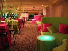 Bar Mitzvah & Bat Mitzvah Decor & Design: Green Furniture with Pink and Green Pillows. Illuminated Tables by MME Event Design & Productions. mmeentertainment.com. Plan your Bat Mitzvah with us now: 877.885.0705 | 212.971.5353