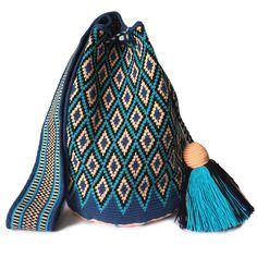 $114.00 USD Traditional single-thread large mochila bags are one of the most iconic crafts in Colombia. Each piece has taken over 20 days to make and is sure to last you throughout the years. Make it your go to bag for this summer. It's hard to have just one! Tapestry Crochet Patterns, Tapestry Bag, Crochet Tote, Boutique Stores, Large Bags, Fashion Bags, Bucket Bag, Purses And Bags, Poufs