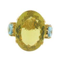 18K gold citrine and blue topaz ring.