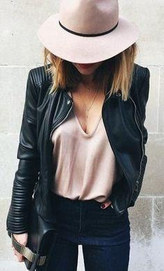 pink cami top & hat. black leather biker jacket.