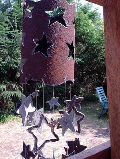 Artist Shirra Wall's handmade wind chimes from recycled stove pipes feature star-shaped cut-outs that dangle and sing with the breeze.