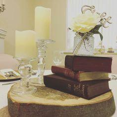 Vintage inspired, with the use of wood slice, old books for height mason jar with table number. And two glass pillar candle stands x Wood Slice Centerpiece, Centrepiece Ideas, Wood Centerpieces, Centrepieces, Table Decorations, Candle Stands, Glass Candle Holders, Baby Wedding, Dream Wedding