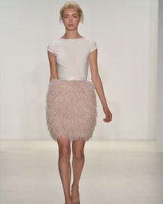 Nontraditional wedding dress with feathers   Click to view more styles