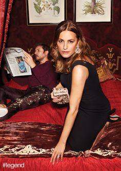 Simon wears a sweatshirt and pyjama trousers by Dolce & Gabbana. Yasmin wears dress and clutch by Dolce & Gabbana, earrings by Chopard and shoes by Paula Cademartori