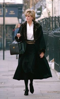 Princess Diana walking down the street with her bag open!!