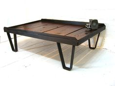 Reserved---Do Not Buy-- Vintage Industrial Foundry Table Dark Wood and Iron Metal Coffee Table. $349.00, via Etsy.