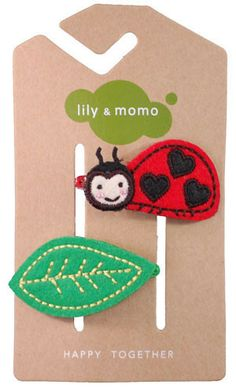 Lily and Momo: Lady Bug Hair Clip (Black/Red) Lily and Momo's whimsical flower and animal themed hair clips and headbands are high-quality, handmade designs featuring felt and fabric styles that spark the imagination in the little girls wearing them. Lily and Momo are also conscientious of the environment, so they stick to only recycled packaging.