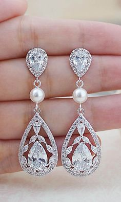 Luxury cubic zirconia drops with Swarovski Pearls Bridal Earrings See more here: http://www.earringsnation.com/jewelry/floral-cubic-zirconia-with-swarovski-pearls-bridal-earrings#.Vdz88Pmqqko