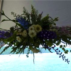 Wedding tent flower decoration overlooking Lake Champlain!