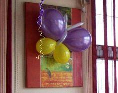 Fluturi din baloane Fluturasi realizati din baloane umflate cu aer.  Trebuie agatati, nu pot fi realizati cu Heliu.  Se pot prinde pe stalpi, aplice, geamuri, draperii, perdele, etc. Agate, Agates