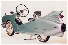 Cadillac petal car-bike.... by far THE coolest bike or pedal car ever made!
