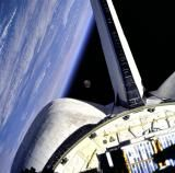 Earth and its moon are nicely framed in this image taken from the aft windows of the Space Shuttle Discovery in (Photo by NASA) Neil Armstrong, Cosmos, Solar System Exploration, Space Exploration, Space Telescope, Space Shuttle, Space Images, Life Images, Space Photos
