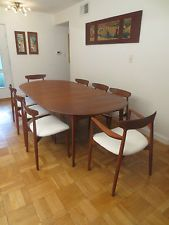 Nice example of the classic Danish dining table. This one goes from round to a relatively large oval by adding the two leaves. Table seats six comfortably. Table is in very good condition with only minimal surface wear. Midcentury Modern Dining Table, Mid Century Modern Furniture, Kitchen Dining, Dining Room, Table Seating, Danish, Teak, Mid-century Modern, Leaves