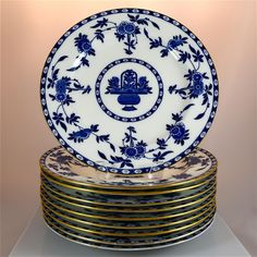 RARE set of 10 gilded dinner plates in classic blue and white Delft pattern by Minton 1920s. Pattern #G1613 was designed for Minton by Henry Bourne in 1871 and remained in production for 129 years, making it one of the most successful patterns in the history of tableware. These plates have an interesting provenance, coming from the family of Senator William Hunter, owner of Hunter House, Newport, Rhode Island in the 1800s.  #MusesAntiques #RubyLane
