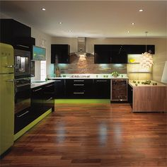 Black and lime green kitchen, with matching Smeg fridge, awesome! http://housetohome.media.ipcdigital.co.uk/96%257C000000ce4%257C6d61_MCHMKR.EBONY1.jpg