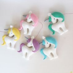 Rainbow garland of 5 unicorns: yellow, light pink, purple, blue, green With silver horn. A beautiful decor in any girls room. This listing