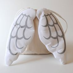 wing pillows on a draw-string bag