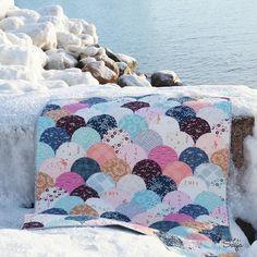 Clamshell quilt using Amy Sinibaldi Playground fabric