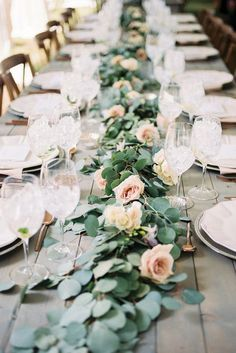 I love the idea of using minimalist greenery garland on tables instead of centerpieces. Nice for a winter wedding.