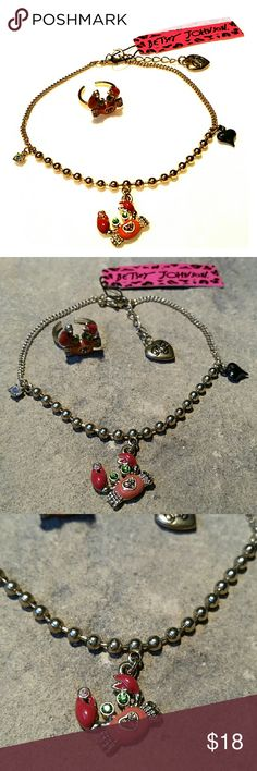 """Crab Ankle Bracelet & Toe Ring Set Betsey Johnson New with tag Betsey Johnson anklet & toe ring set in shiny polished gold metal starring coral and red crabs with yellow crystal rhinestone hearts in the center, sparkling green eyes, each clutching their prize aurora borealis crystals in one claw. The anklet also has an aurora charm & black metal puffy heart charm. Toe ring is adjustable size. Ankle bracelet is 9"""" plus 1"""" extension with BJ heart.  Thank you for checking out my closet, and…"""