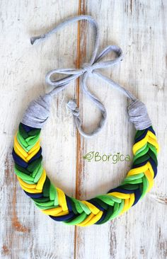 Upcycled design necklace. Length: approx. 55 cm.  All t-shirts are laundered before starting anew. Item can be handwashed and laid flat to dry.  Please visit my facebook page: https://www.facebook.com/borgicadesign