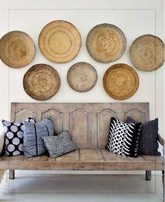 I like the rustic, indigo, island, naturals vibe  interiors magazine winnowing baskets