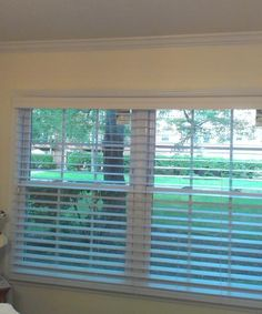 """Our customer said: """"The Ultimate 2 1/2 Faux Wood Blinds are everything I wished they would be and MORE! They create a beautiful elegance in our kitchen and bedroom windows."""""""