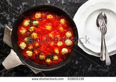 Tasty Meatballs from ricotta cheese in Tomato sauce in a frying pan on a dark background