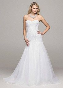 Sweetheart neckline, full skirt, beaded appliques; this eye-catching and ultra-romantic wedding dress has all the right elements to make the perfect gown!  Trumpetgown features aflattering and delicate sweetheart neckline.  Beaded lace appliques adorn the bodice adding a radiant touch.  Full tulle skirt creates a dramatic feel and finishes off the look.  Sweep train. Sizes 0-14.  Available in stores and online in White. Ivory available for Special Order in stores.  Petite: Style ...
