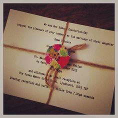 Homemade wedding invitations, tied with twine and beautiful wooden button detail
