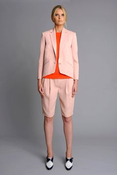 Rachel Roy, Spring 2012. Light, soft pink with bright accents.  Look out for this jacket style throughout the season.