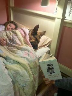 Child and German Shepard in bed asleep during bedtime story reading !! My Bella is just like this... They are the Best dogs