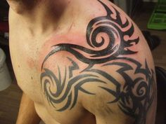 tribal shoulder tattoos for man tribal tattoo meaning for forearm