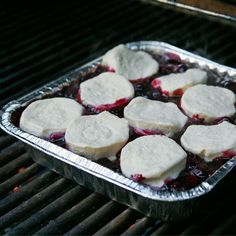 Blueberry Cobbler | So easy: Toss blueberries on the grill, then add biscuit dough and cover everything up. The biscuits will brown, the blueberries will warm, and all will be right in the world.  tablespoon.com