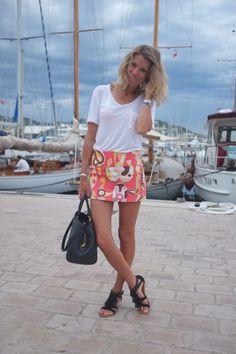 T-shirt: IRO, skirt: Emilio Pucci, sandals: Minnetonka, bag: Louis Vuitton Montaigne GM in Monogram Empreinte